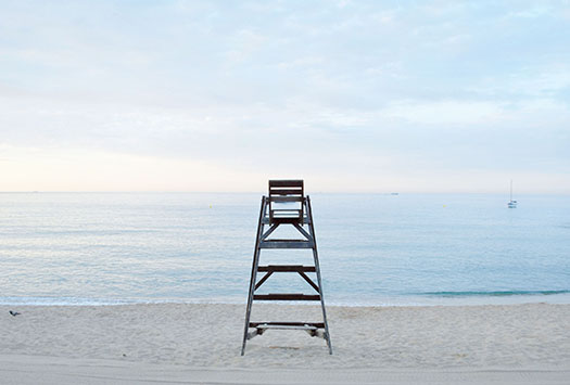 Beach with empty safeguard ladder